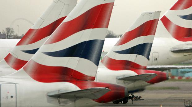 IAG said third-quarter profits were hit by higher fuel costs (Tim Ockenden/PA)