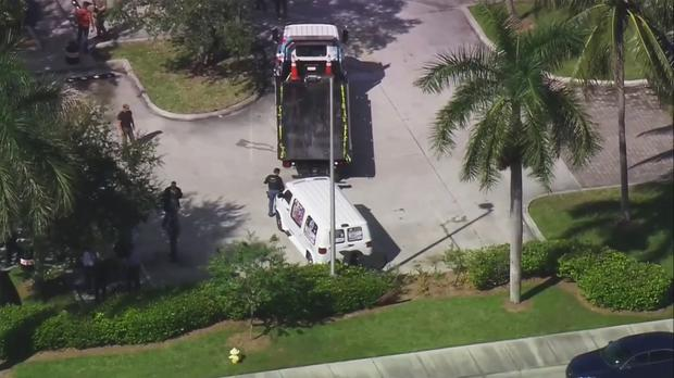 FBI agents and police investigate a suspicious van (WPLG-TV via AP)