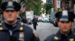 Alert: US law enforcement officials respond to a suspicious package at a US Post Office facility in Manhattan last week. Photo: Getty Images