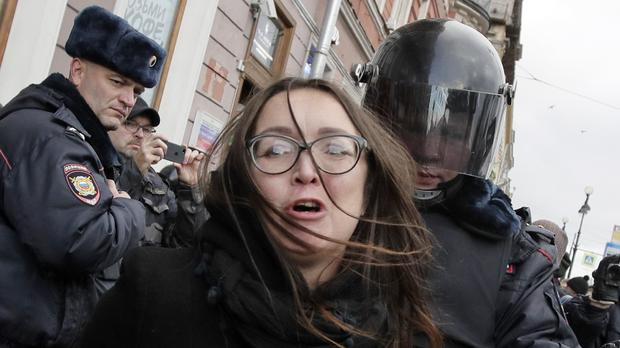 A policeman detains a protester during a rally in support of the defendants involved in the Novoye Velichye (New Greatness) case in St Petersburg (AP)