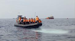 Rescuers search for victims of a Lion Air passenger jet that crashed in the waters off Tanjung Karawang (AP)