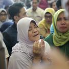 Relatives began to gather at the airport on Monday (AP/Hadi Sutrisno)