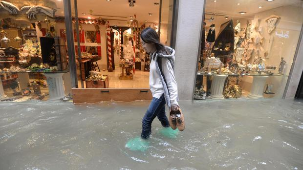 146787c7c Venice hit by high tide as six killed across Italy by wind and ...