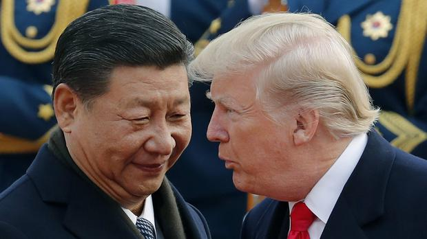 US President Donald Trump, right, chats with Chinese President Xi Jinping (AP Photo/Andy Wong, File)