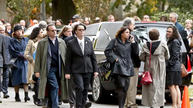 Visitors walk past the hearse as they gather for the funeral of Rose Mallinger, 97 (Keith Srakocic/AP)