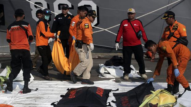 Rescuers carry body bags containing the remains of the victims of Lion Air crash at Tanjung Priok Port in Jakarta, Indonesia (Binsar Bakkara/AP)