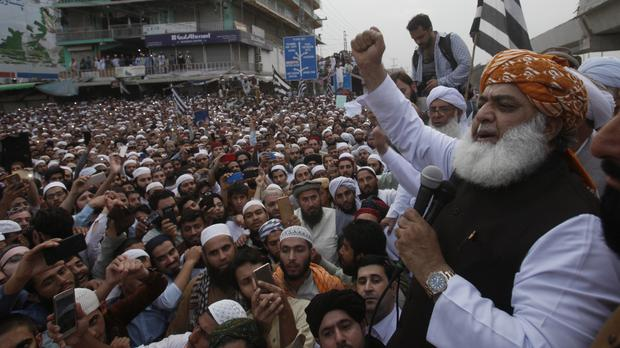 Maulana Fazalur Rehman, leader of religious party Jamiat Ulema-e-Islam addresses a rally to condemn a Supreme Court decision that acquitted Asia Bibi (Muhammad Sajjad/AP)