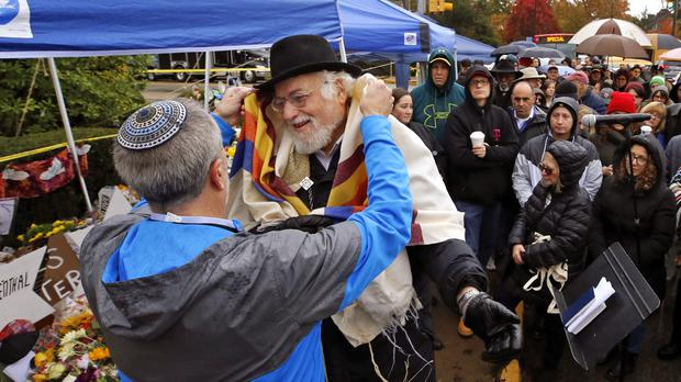 Chuck Diamond, second from left, prepares to lead a Shabbat morning service outside the Tree of Life Synagogue (Gene J. Puskar/AP)