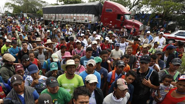 Central American migrants wait to get a ride on a truck, in Isla, Veracruz state (AP)