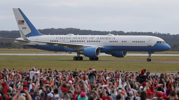 Air Force One taxis past a large crowd as President Donald Trump arrives for a rally in Georgia (John Bazemore/AP)