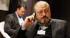 Murdered: Saudi journalist Jamal Khashoggi on his phone at the World Economic Forum in Davos, Switzerland. Photo: PA