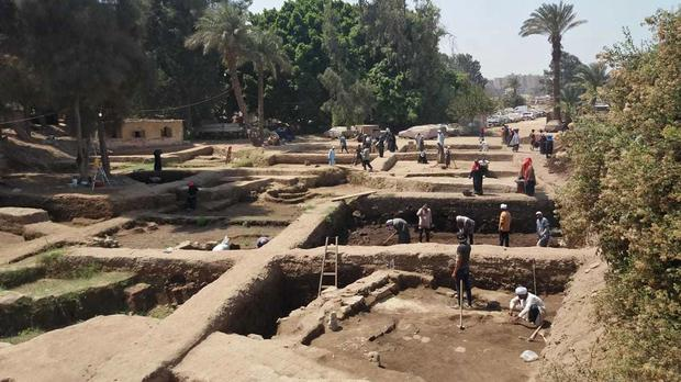 Archaeologists working at a dig in eastern Cairo's Matariya neighbourhood (Egypt Antiquities Ministry/AP)
