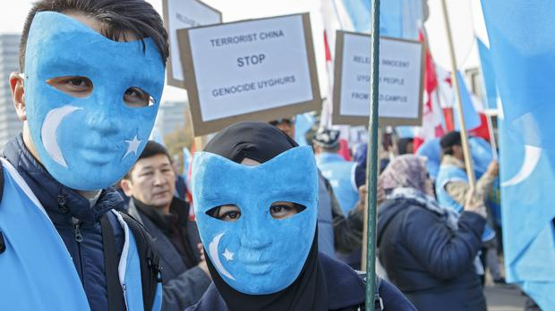 Uighurs demonstrate against China during the Universal Periodic Review of China by the Human Rights Council (Salvatore di Nolfi/AP)