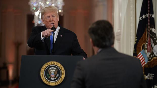 Trump Blasts 'Unprofessional' Jim Acosta and 'Loser' April Ryan