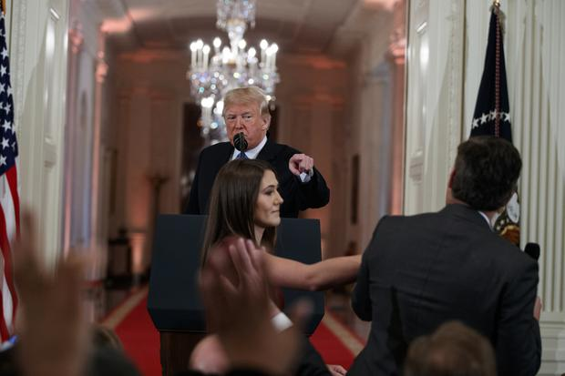 A White House aide reached for the microphone from CNN's Jim Acosta