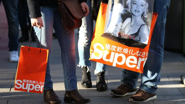 Superdry sales rose in the first half despite a run of hot weather hitting demand for its signature winter clothing (Steven Paston/PA)