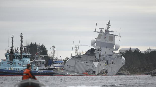 The Norwegian frigate KNM Helge Ingstad, right, after a collision with the tanker Sola TS (Mari Hommedal/AP)