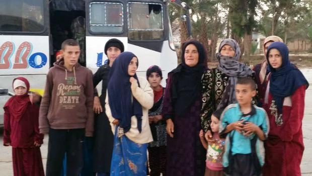 Women and children liberated from the Islamic State group (SANA via AP)
