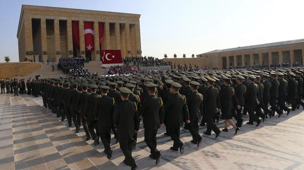 Turkish army officers and soldiers walk at the mausoleum of the nation's founding father Mustafa Kemal Ataturk (Burhan Ozbilici/AP)