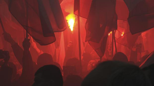 Marchers burned flares during the March of Independence (Alik Keplicz/AP)