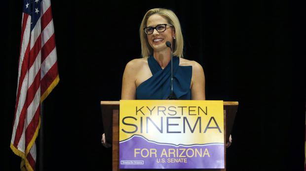 Kyrsten Sinema declares victory over Republican challenger Martha McSally on Monday (AP Photo/Rick Scuteri)
