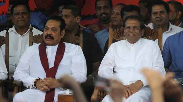 Sri Lankan president Maithripala Sirisena, right, and his appointed prime minister Mahinda Rajapaksa (Eranga Jayawardena/AP)