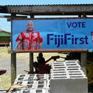 A FijiFirst poster with the image of Fiji's prime minister (AP)