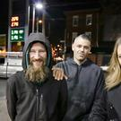 Johnny Bobbitt, left, Kate McClure, right, and Mark D'Amico pose at a Citgo petrol station in Philadelphia (Elizabeth Robertson/The Philadelphia Inquirer via AP)