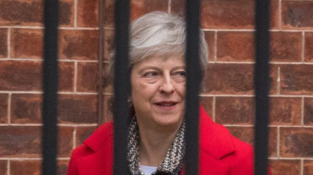 Prime Minister Theresa May leaves from the rear entrance of 10 Downing Street, Westminster, London.