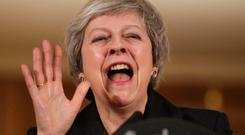 Good humour: Prime Minister Theresa May reacts during a press conference at 10 Downing Street, London, to discuss her Brexit plans. Picture: PA