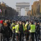 Protesters block the Champs-Elysees to protest against fuel taxes (Michel Euler/AP)