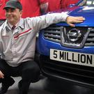 Carlos Ghosn, president and chief executive of Nissan, with the 5 millionth car – a Qashqai – to roll off the production line at its Sunderland plant.