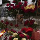 Flowers are placed on the tomb of former Spanish dictator Francisco Franco inside the basilica at the the Valley of the Fallen (Manu Fernandez/AP)