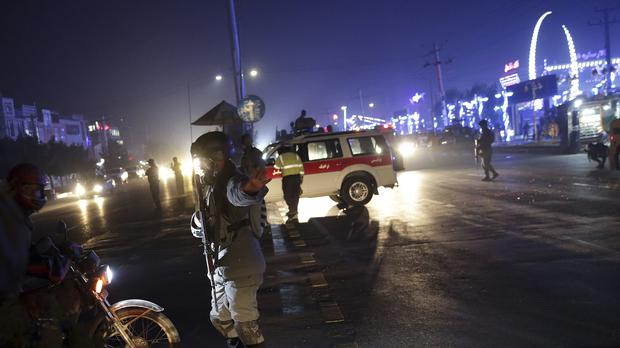 Security forces block the roads at the site of the suicide attack in Kabul, (Massoud Hossaini/AP)