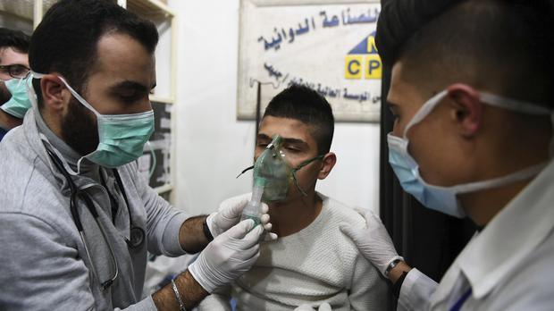 A child receiving oxygen through respirators following a suspected chemical attack on his town of al-Khalidiya (SANA via AP)
