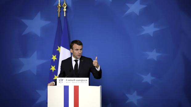 French President Emmanuel Macron speaks during a media conference at the conclusion of the EU summit in Brussels (AP Photo/Olivier Matthys)