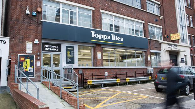 Topps Tiles said it would increase stock levels of key selling lines (Topps Tiles/PA)