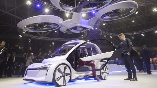 A man gets out of the Pop.Up Next, a prototype designed by Audi, Airbus and Italdesign (Peter Dejong/PA)