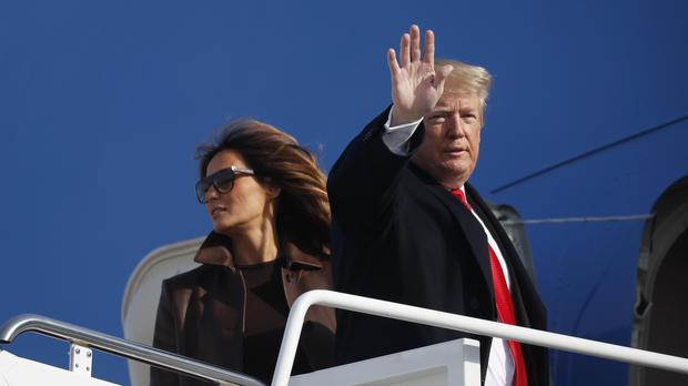 President Donald Trump and first lady Melania Trump board Air Force One (Pablo Martinez Monsivais/PA)
