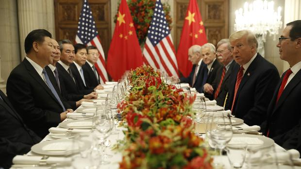 Donald Trump with Xi Jinping during their bilateral meeting on Saturday (AP)