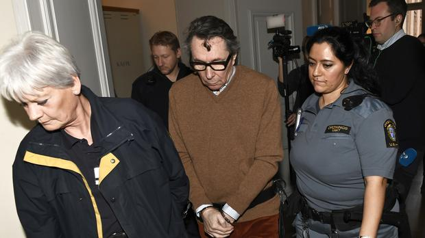 Jean-Claude Arnault, centre, is escorted from court at a previous hearing (Jonas Ekstrome/AP)