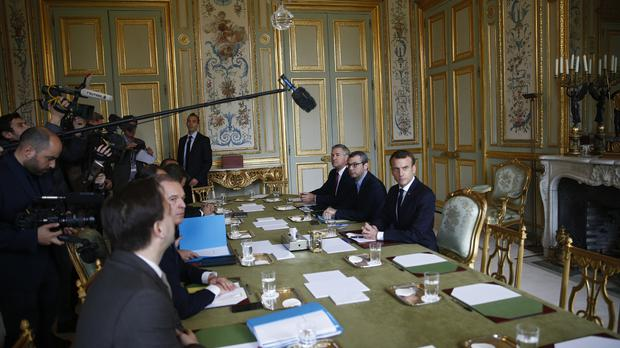 France's President Emmanuel Macron, right, prior to a meeting at the Elysee Palace (Stephane Mahe/AP)
