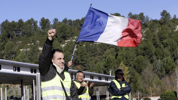 Protesters are vowing to carry on despite concessions from the French government (AP Photo/Claude Paris)