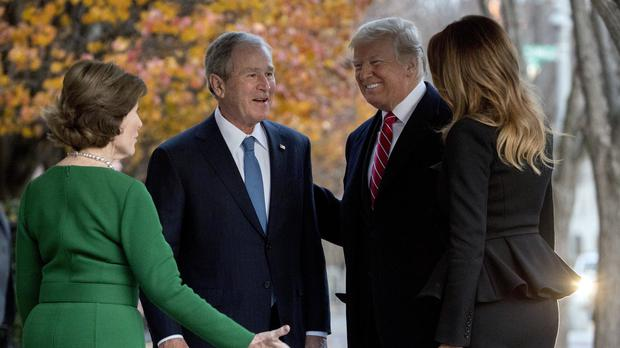 President Donald Trump and first lady Melania Trump are greeted by former president George Bush and former first lady Laura Bush (Andrew Harnik/AP)