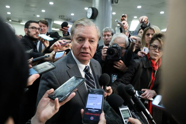 'You'd have to be blind': Lindsey Graham speaks to reporters. Photo: REUTERS/Jonathan Ernst