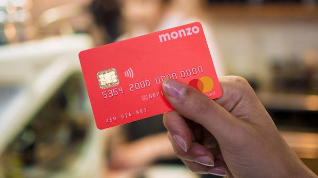 Monzo, known for its pink debit card, hit its £20 million crowdfunding target.