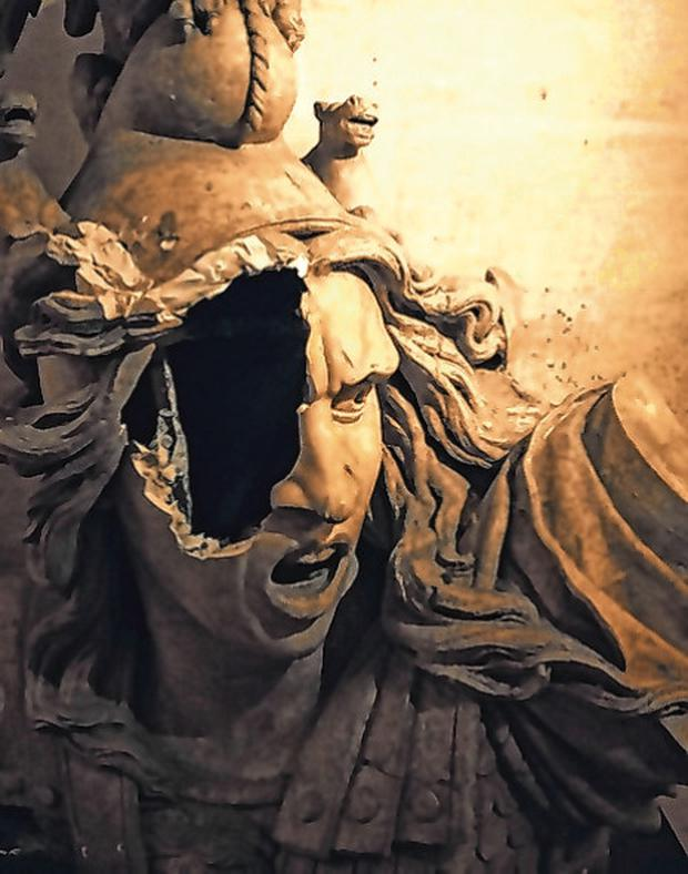 The damaged statue of Marianne following Paris riots. Photo: AP