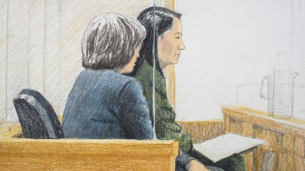 Meng Wanzhou sits beside a translator during a bail hearing at British Columbia Supreme Court in Vancouver (Jane Wolsak/The Canadian Press via AP)