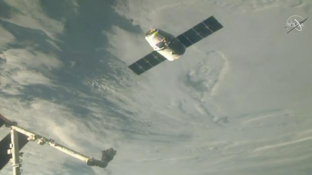 The SpaceX Dragon cargo spacecraft approaches the robotic arm for docking to the International Space Station (NASA TV via AP)