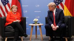 US President Donald Trump with German Chancellor Angela Merkel. Photo: Pablo Martinez Monsivais/AP